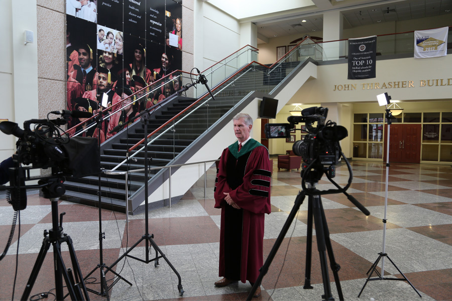 College of Medicine Dean John P. Fogarty records a message for the graduating class. (Mark Bauer/College of Medicine)