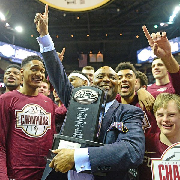 FSU men's basketball head coach Leonard Hamilton celebrates the 2019-2020 ACC Championship with his team.