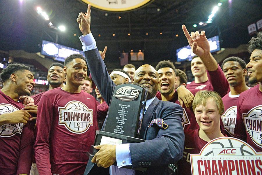 FSU men's basketball head coach Leonard Hamilton celebrates the 2019-2020 ACC Championship with his team.