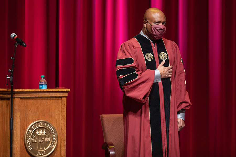 FSU men's basketball coach Leonard Hamilton stands for the Pledge of Allegiance during Florida State University's virtual summer commencement ceremony, which was streamed online Friday, July 31, 2020. (FSU Photography Services)
