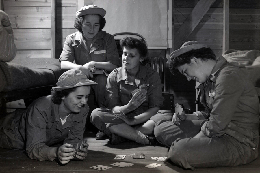 Soldiers playing cards in a photo from Charlotte Mansfield's World War II scrapbooks. Courtesy of the Institute on World War II and the Human Experience.