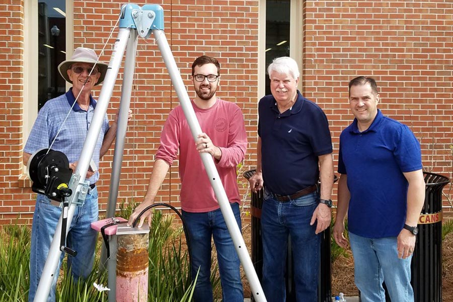 From left, Bob Hutt, geology graduate student James Eke, former EOAS chair James Tull and assistant research specialist Gary White. Photo by: FSU Photography Services