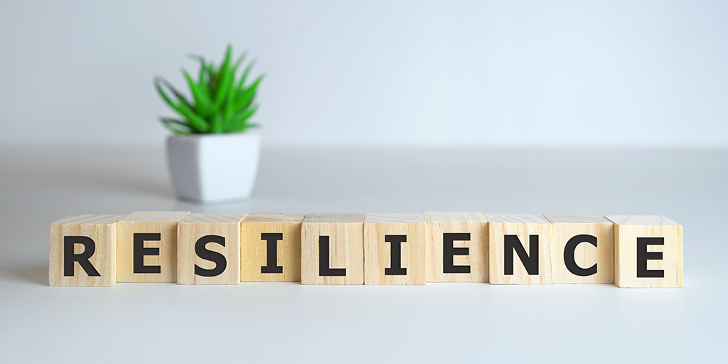 Resilience word concept on cubes on white background.