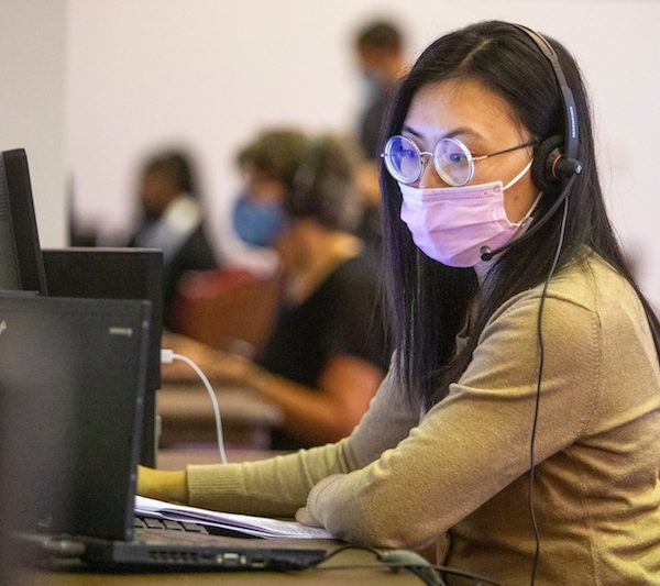 Yen Lam, a member of the SAFER team, handles incoming calls and outreach as part of COVID-19 contact assessment efforts.