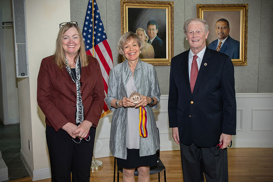 """Provost Sally McRorie, Patsy Palmer and President John Thrasher gather to honor late President Emeritus Talbot """"Sandy"""" D'Alemberte during a Sept. 22 ceremony at the College of Law. (FSU Photography Services)"""