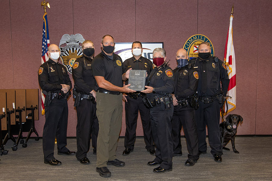 FSUPD accepts first-place in the Champions Category of the 2020 Florida Law Enforcement Challenge Awards. From left: Officer Chase Yarborough, Officer Dan Cutchins, Law Enforcement Liaison Andy Johnson, Lt. John Baker, Chief Terri Brown, Officer Steve Black, Officer Adam Walker and K9 Tomahawk. (FSU Photography Services)