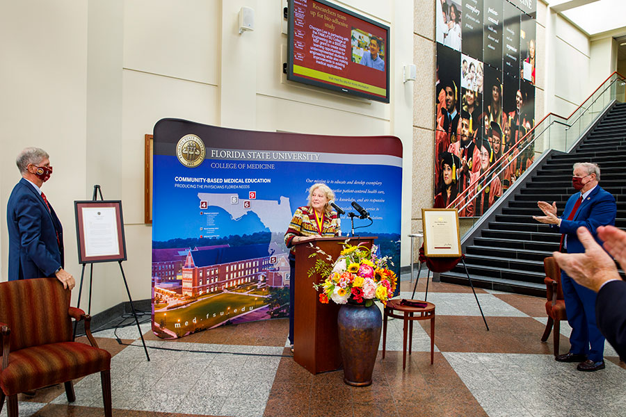 FSU College of Medicine Dean John P. Fogarty (left) and President John Thrasher (right) look on as Myra Hurt gives remarks during her Westcott Medal award ceremony Sept. 2, 2020, at the College of Medicine.(FSU College of Medicine)
