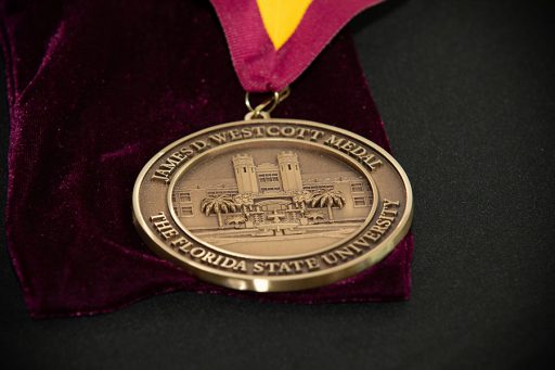 "The James D. Westcott Distinguished Service Medal recognizes a ""person whose distinguished service merits exceptional recognition and whose life and work exemplifies the Vires, Artes and Mores, which the university seeks to nurture in its students."""