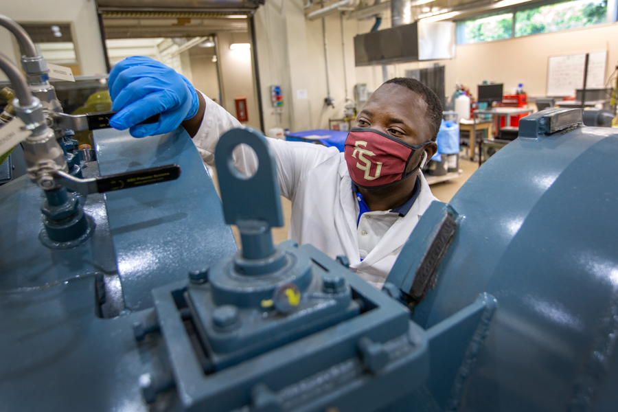 Abiodun Oluwalo, graduate student in the manufacturing bay of the Materials Research Building at HPMI