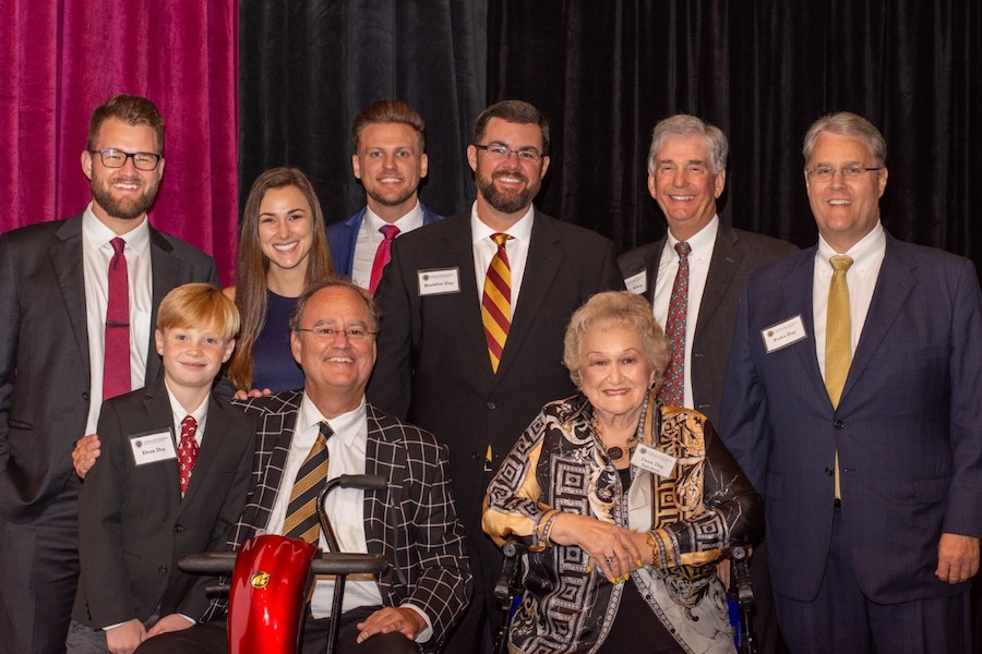 Members of the Day family from left to right: Philip Day, Dean Day, Caroline Delorenzo, Clint Day, Richard Delorenzo, Brandon Day, Deen Day Sanders, Woody White, President of the Cecil B. Day Foundation and Parke Day