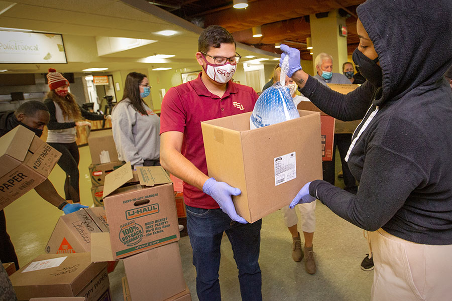 Students from Florida State University and Florida A&M University partnered with the Leon County Sheriff's Office to pack boxes with a full Thanksgiving meal for Tallahassee residents in need this year. (FSU Photography Services/Bruce Palmer)