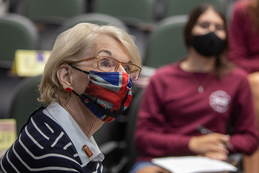 Karioth listens to a student deliver a speech in one of her healthcare-related public speaking courses. (FSU Photography Services)
