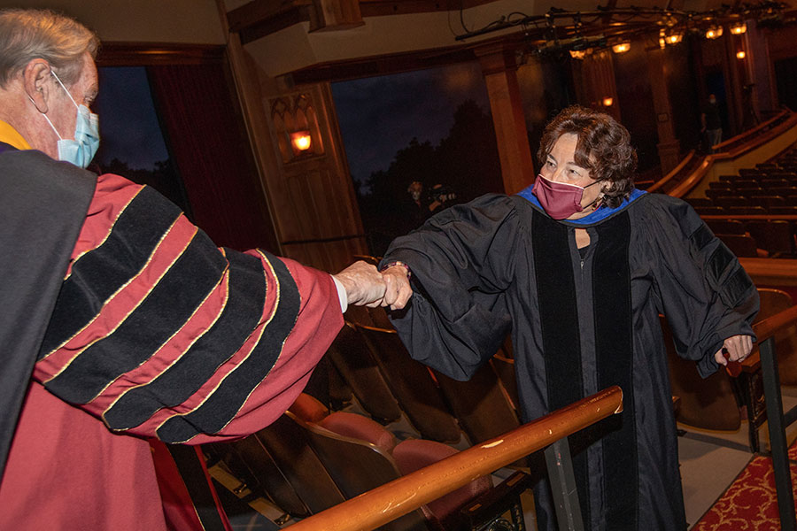 President John Thrasher greets Professor Sharon Nicholson before fall virtual commencement, which was webcast Friday, Dec. 11, 2020. (FSU Photography Services)