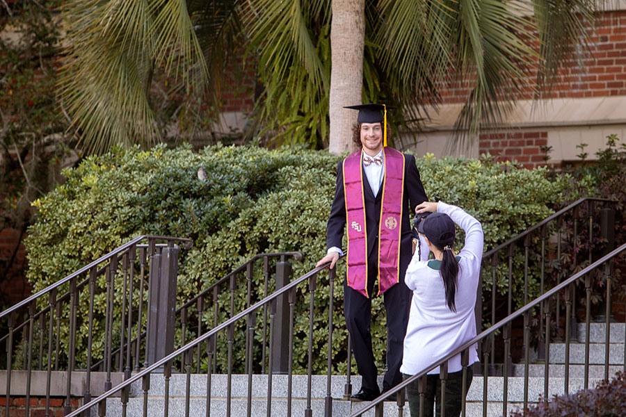 New Florida State University graduates celebrate with the tradition of photo shoots in Westcott Plaza leading up to fall virtual commencement Dec. 12, 2020. (FSU Photography Services)