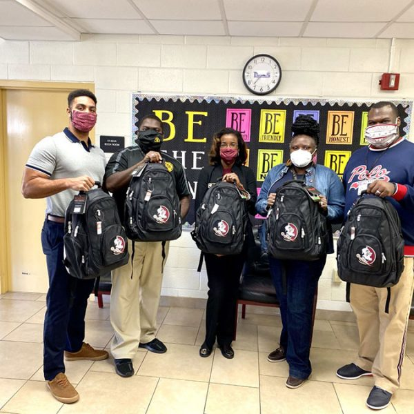 As part of FSU CARE's Back to School Drive, CARE staff dropped off backpacks and school supplies at R. Frank Nims Middle School in Leon County. The funding that CARE recently received will continue to support efforts like this. From left to right: CARE Program Assistant TJ Callan, Nims Principal Dr. Benny Bolden, CARE Assistant Director Inika Williams, Law Magnet Coordinator Altovise Mitchell, and Nims Assistant Principal Tyneal Haywood Sr. (CARE/Inika Williams)