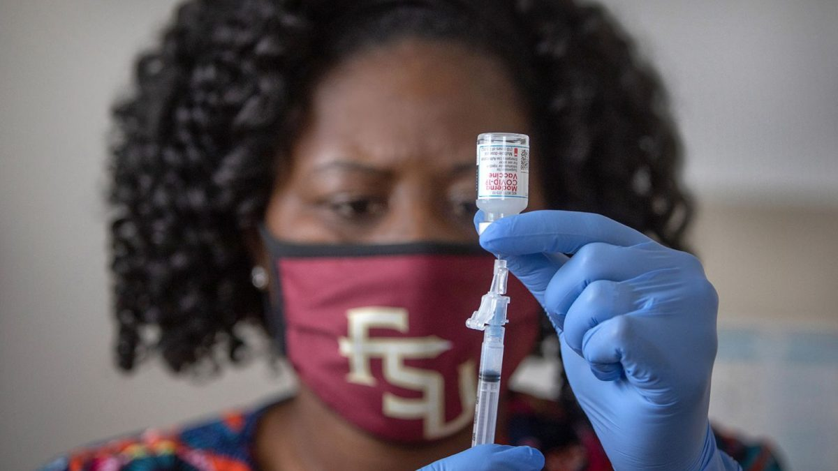 Latricia Simmons, RN, assistant director of Clinical Operations at University Health Services draws up a dose of the COVID-19 vaccine. (FSU Photography Services)