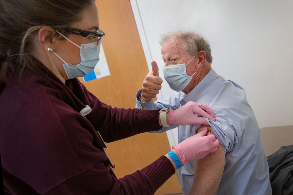 President John Thrasher gives a thumbs up after receiving the COVID-19 vaccine at University Health Services. (FSU Photography Services)