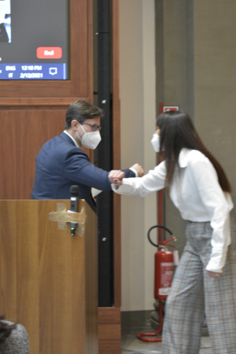 Mayor Dario Nardella and Lucia Cossari, associate director of FSU International Programs Italy, greet each other with elbow taps at the ceremony inside FSU's Florence study center.