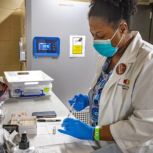 A registered nurse from FSU University Health Services prepare COVID-19 vaccines for patients at the Donald L. Tucker Civic Center. (FSU Photography Services / Bil Lax)