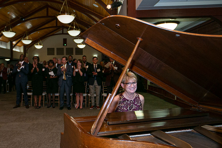 """Mrs. Cottrell plays """"Hymn of the Garnet and Gold"""" on the piano at an FSU event."""