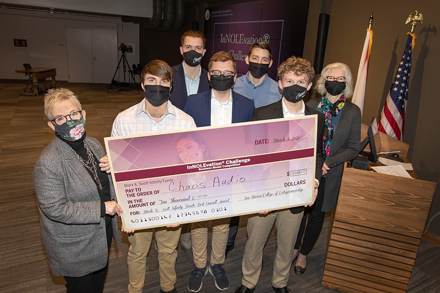Front row from the left: Susan Fiorito, Dean of the Jim Moran College, with Cameron Jones, Samuel Lamb and Landon McCoy, of Audio Chaos and Wendy Plant, director of the InNOLEvation competition. Back row: Armis Sunday, Robert Copsey of Audio Chaos.