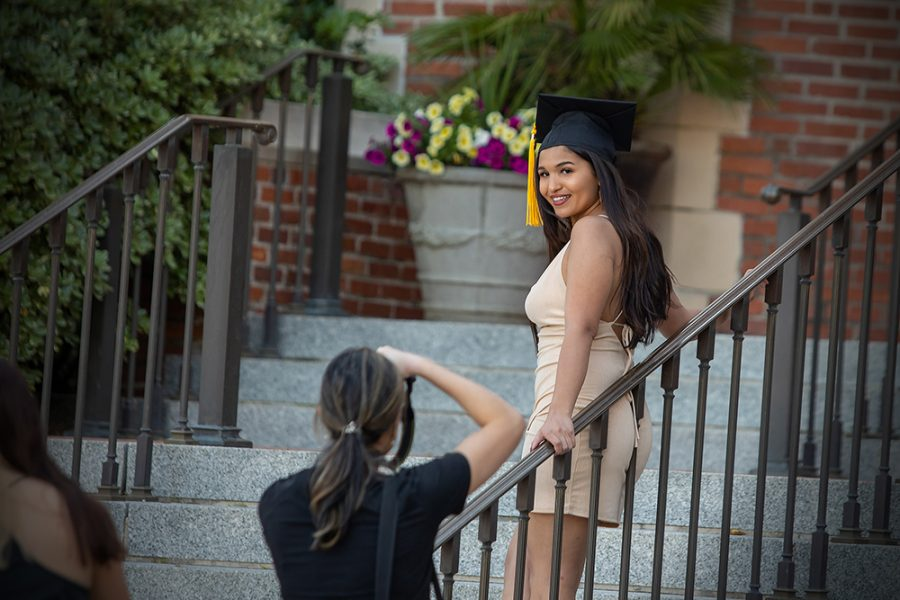 Graduates taking photos in Westcott Plaza (FSU Photography Services) 2021