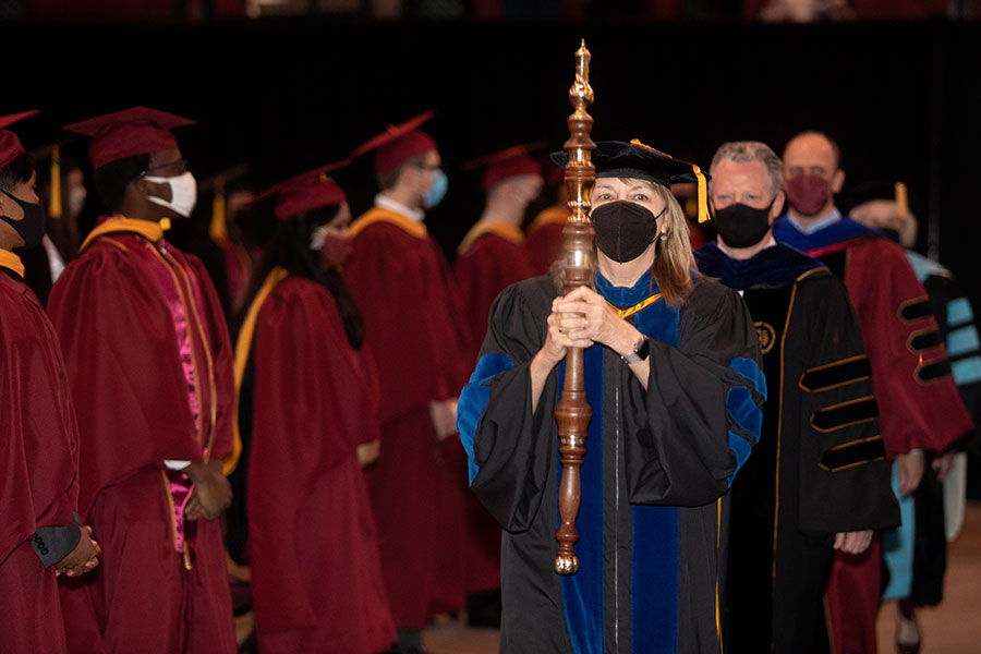Vice President for Faculty Development and Advancement Janet Kistner careers in the mace during FSU's first in-person commencement ceremony since December 2019 on Saturday, April 17, 2021, at the Donald L. Tucker Civic Center. (FSU Photography Services)