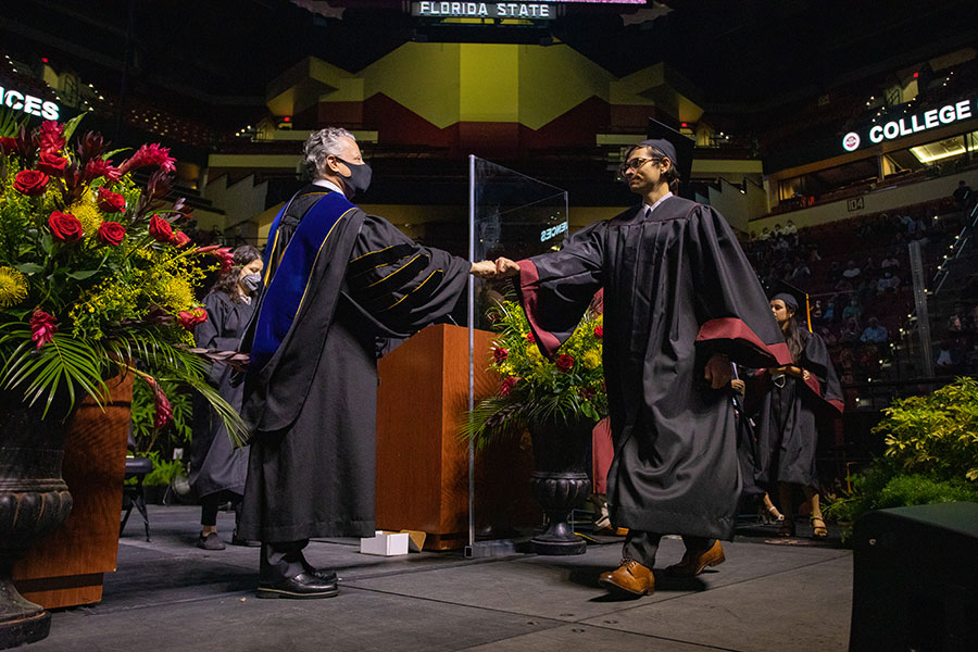 College of Arts and Science Dean Sam Huckaba congratulates graduates during spring commencement Saturday, April 17, 2021, at the Donald L. Tucker Civic Center. (FSU Photography Services)
