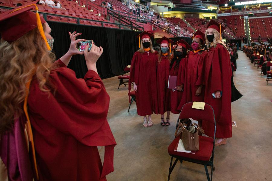 Graduates snap photos at FSU Spring Commencement Friday, April 23, 2021. (FSU Photography Services)