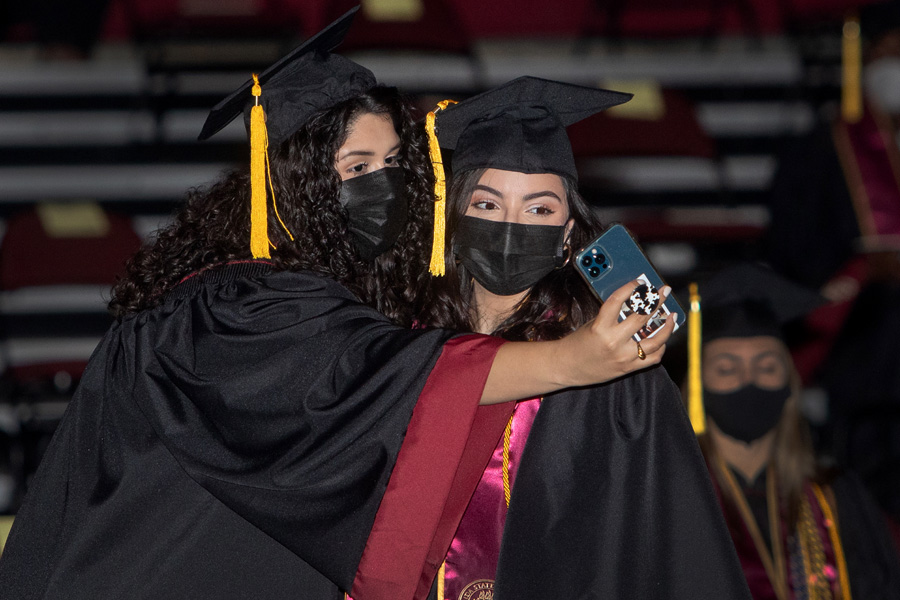 Graduates snap photos during FSU Spring Commencement Friday, April 23, 2021. (FSU Photography Services)