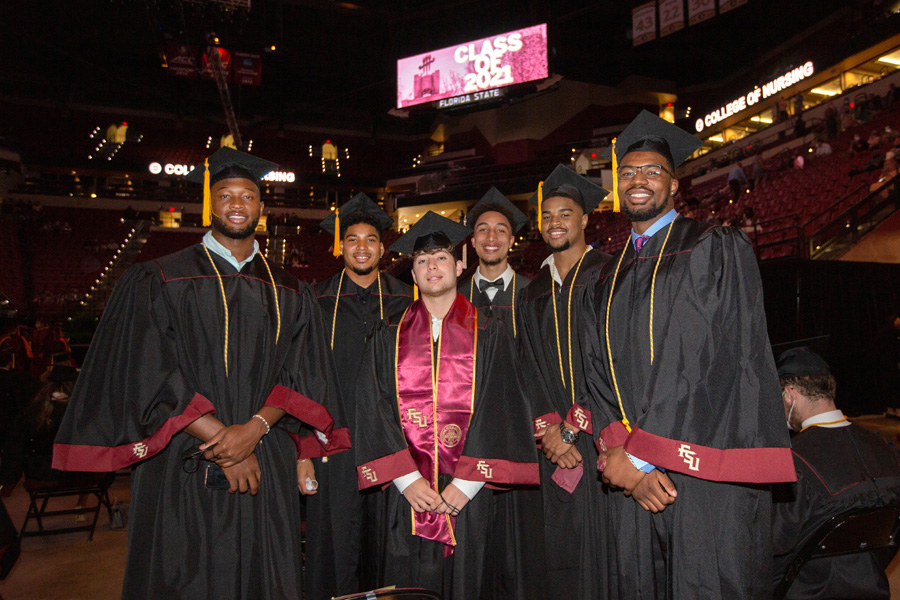 Five of seven graduating men's basketball players, along with manager XX, pose for a photo before the afternoon ceremony of FSU Spring Commencement Friday, April 23, 2021. (FSU Photography Services) 2021