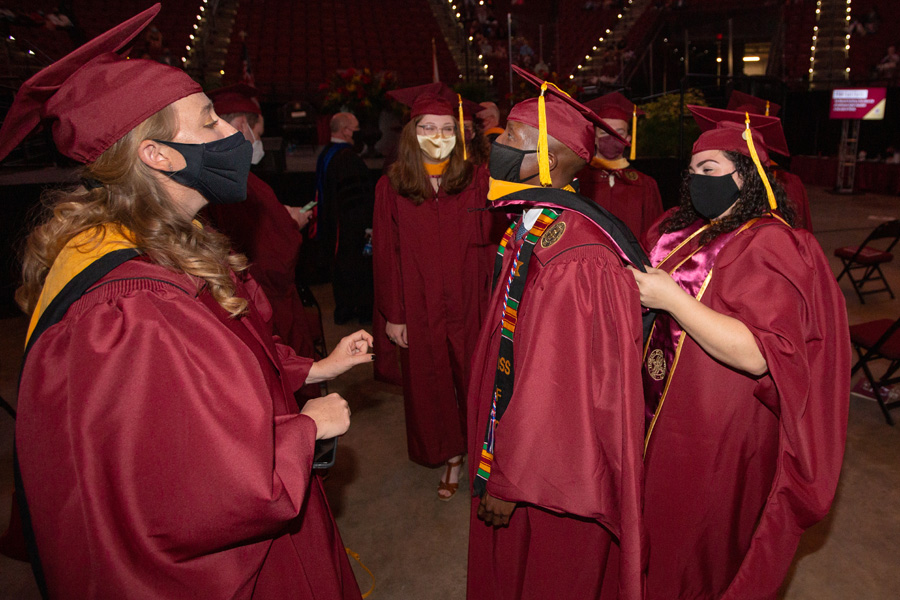 Master's graduates celebrate their achievement before FSU Spring Commencement Friday, April 23, 2021. (FSU Photography Services)