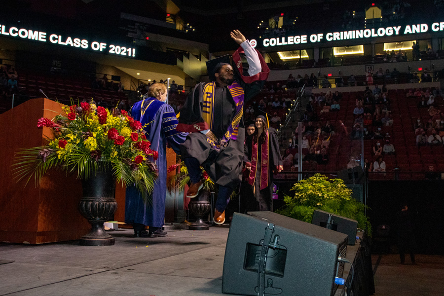 A graduate celebrates at FSU Spring Commencement Friday, April 23, 2021. (FSU Photography Services)