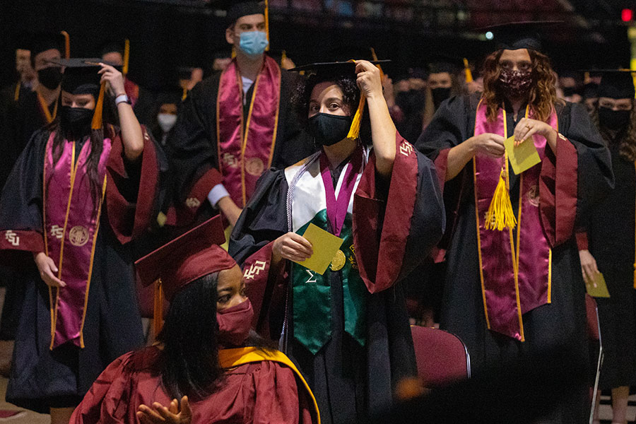 Graduates turn their tassels during FSU's first in-person commencement ceremony since December 2019 on Saturday, April 17, 2021, at the Donald L. Tucker Civic Center. (FSU Photography Services)