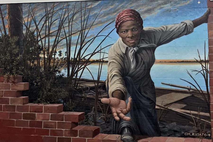 """""""Take My Hand"""" mural by Michael Rosato which depicts Harriet Tubman, an abolitionist and conductor on the Underground Railroad."""