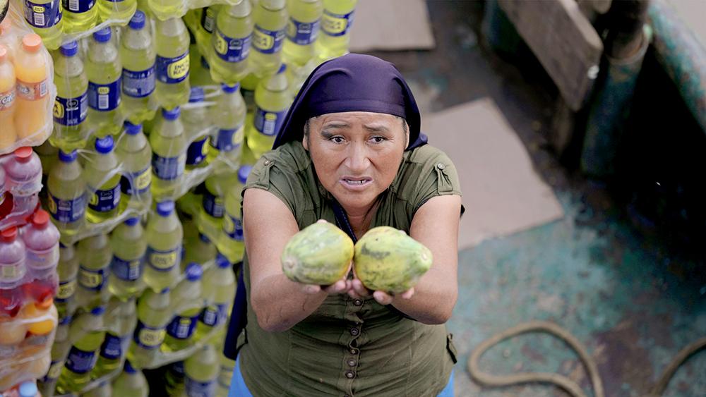 """Marcos Colón, """"Papaya for Sale,"""" a local women sells papayas in Nuevo Pebas, Peru, March 2020."""