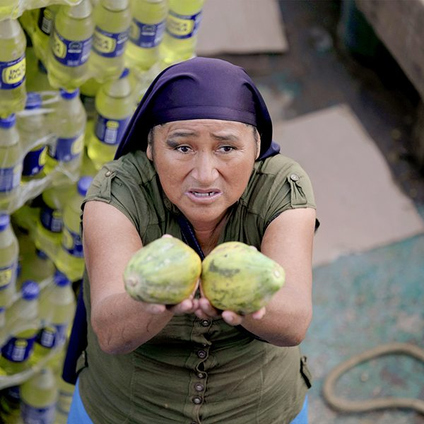 "Marcos Colón, ""Papaya for Sale,"" a local women sells papayas in Nuevo Pebas, Peru, March 2020."