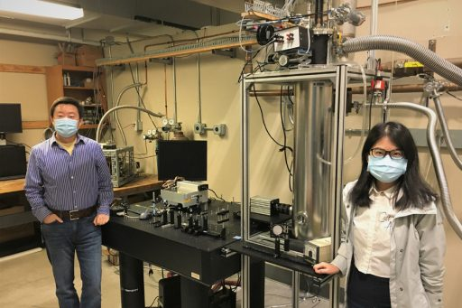 From left, Wei Guo, an associate professor of mechanical engineering at the FAMU-FSU College of Engineering, and Yuan Tang, a postdoctoral researcher at the National High Magnetic Field Laboratory, in front of the experimental setup. (Courtesy of Wei Guo)