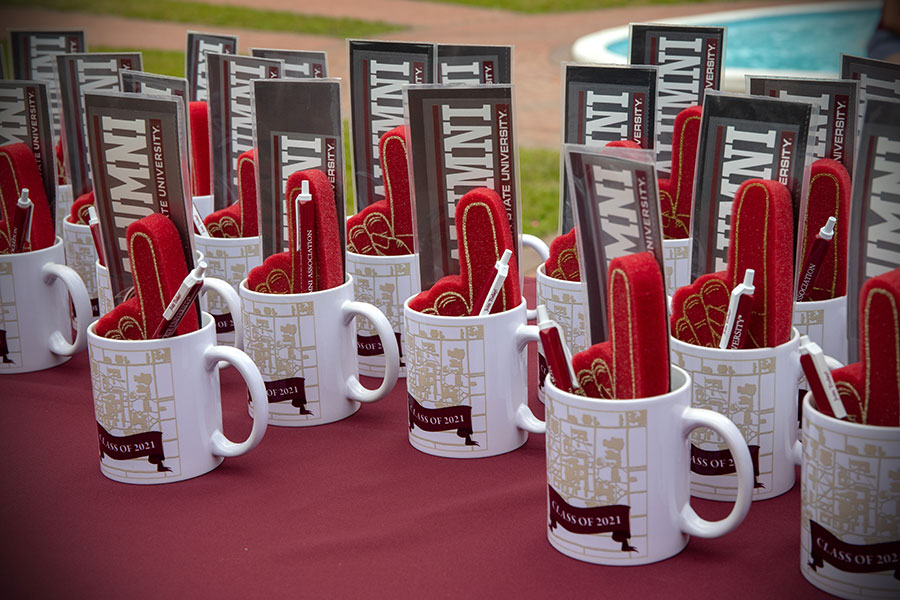 FSU graduates received a few souvenirs during class ring pick-up at Westcott Fountain Thursday, April 8, 2021. (FSU Photography Services)