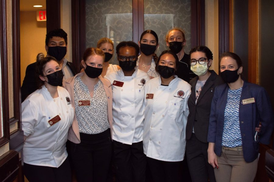 Wearing masks while working is just one of the safety adjustments the students working on the Little Dinner Series have made this year.
