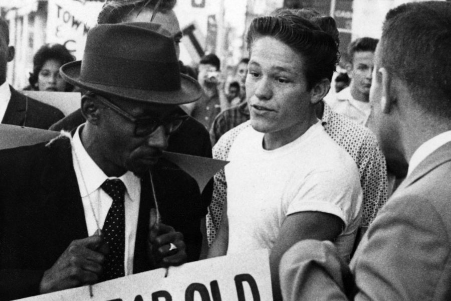 Archival photo (1960) of Reverend C.K. Steele during boycott & picketing of downtown stores due to the lack of progress in desegregating the lunch counters at downtown Tallahassee stores. (Photo courtesy of Florida Memory)