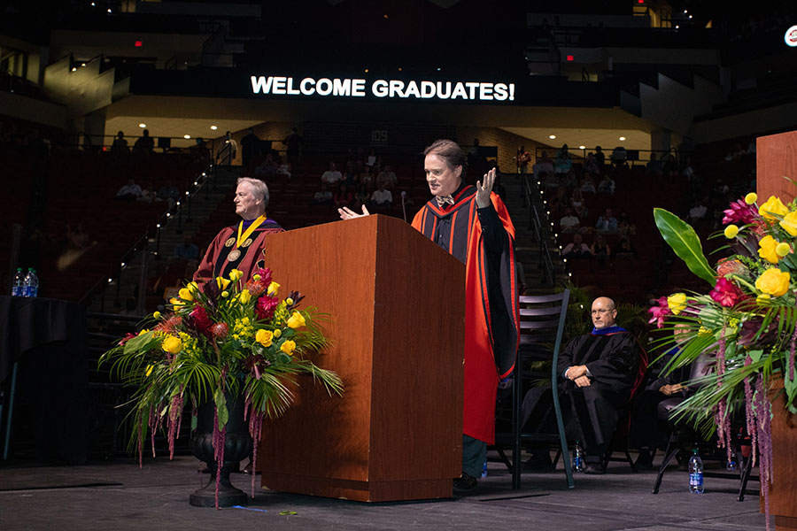 Graduate School Dean Mark Riley confers graduate degrees during a special in-person commencement ceremony for the Class of 2020 Saturday, May 22, 2021, at the Donald L. Tucker Civic Center. (FSU Photography Services)