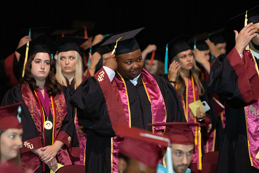 Graduates turn their tassels during a special in-person commencement ceremony for the Class of 2020 Saturday, May 22, 2021, at the Donald L. Tucker Civic Center. (FSU Photography Services)
