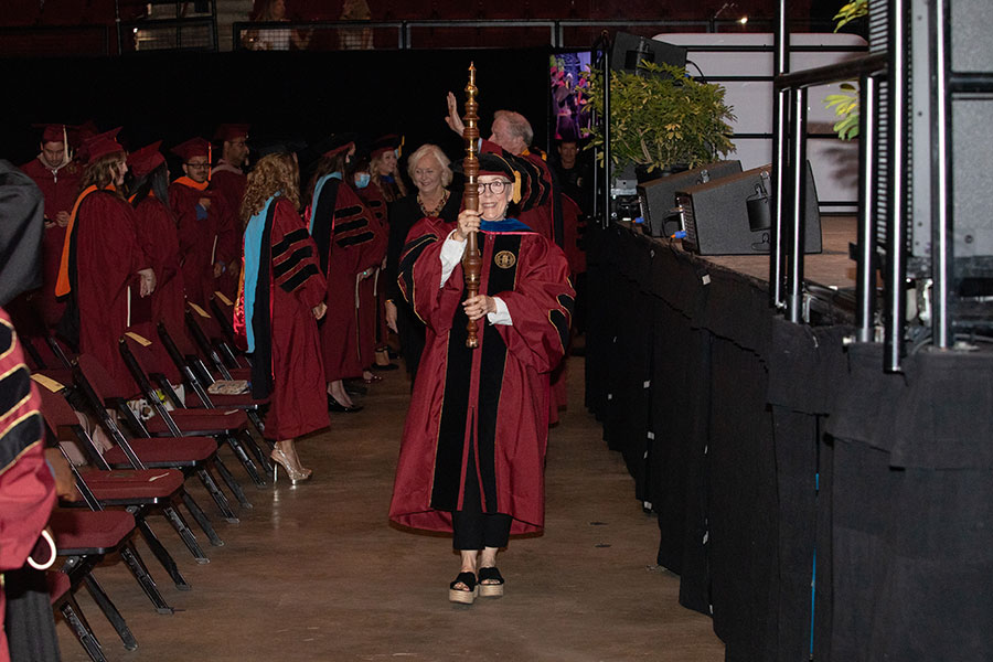 Dean Susan Fiorito carries the academic mace during the recessional of a special in-person commencement ceremony Saturday, May 22, 2021, at the Donald L. Tucker Civic Center. (FSU Photography Services)