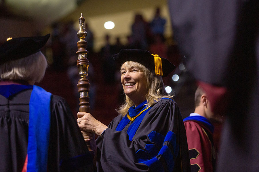 Vice President for Faculty Development and Advancement Janet Kistner carries in the academic mace and leads the processional at a special in-person commencement ceremony for 2020 graduates Saturday, May 22, 2021, at the Donald L. Tucker Civic Center. (FSU Photography Services)