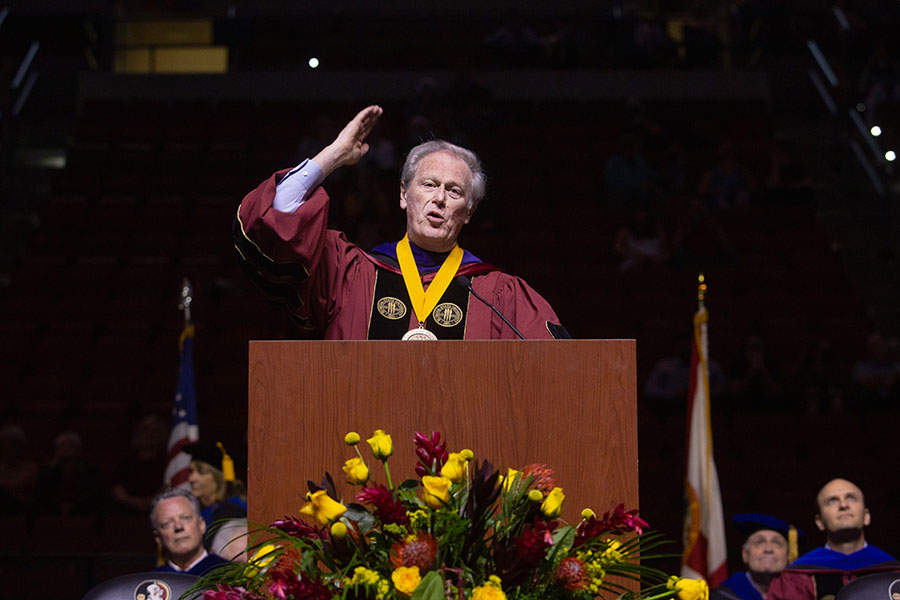 President John Thrasher sends off the crowd with'Go Noles!' during a special in-person commencement ceremony for 2020 graduates Saturday, May 22, 2021, at the Donald L. Tucker Civic Center. (FSU Photography Services)