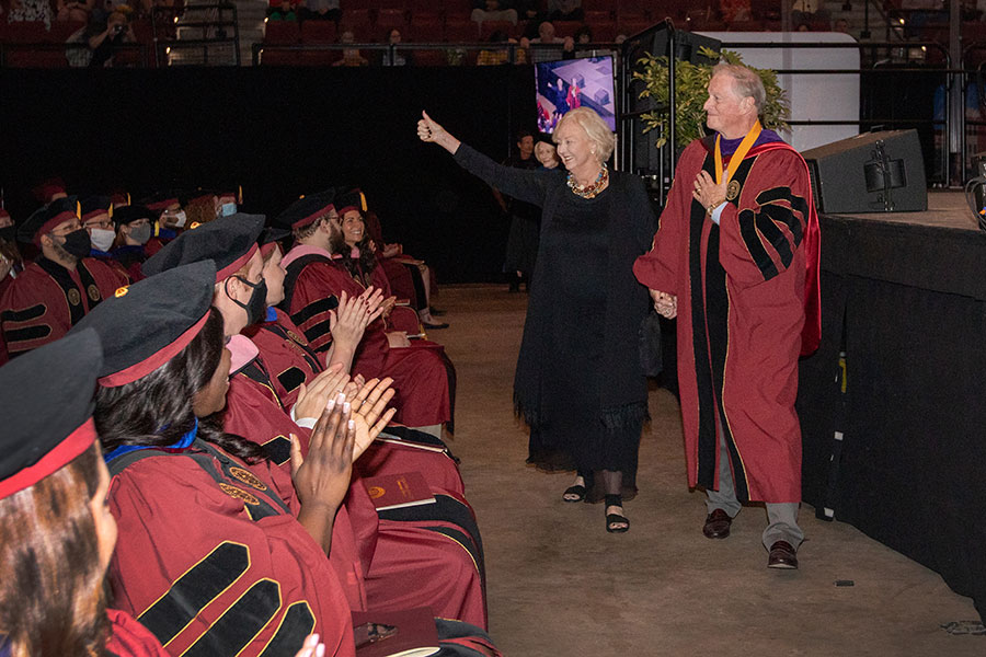 President John Thrasher and FSU First Lady Jean Thrasher receive applause from graduates and their guests during the recessional of a special in-person commencement ceremony for 2020 graduates Saturday, May 22, 2021, at the Donald L. Tucker Civic Center. (FSU Photography Services)