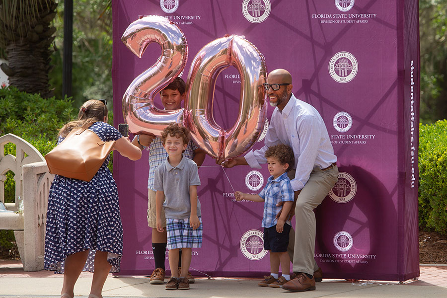 Graduates and their guests celebrate at Westcott Fountain after enjoying a special in-person commencement ceremony for 2020 graduates Saturday, May 22, 2021, at the Donald L. Tucker Civic Center. (FSU Photography Services)