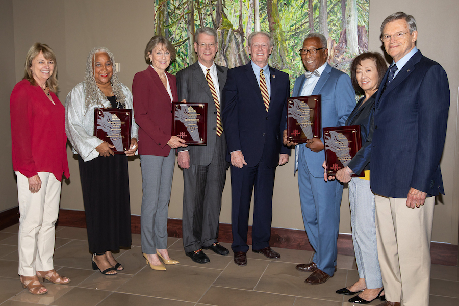 From left to right: Janet Kistner, vice president for faculty development and advancement, Doby Flowers, Paula Peters Smith, Bill Godfrey Smith, John Thrasher, Fred Flowers, Dorothy Jenkins and her husband Charles Jenkins.
