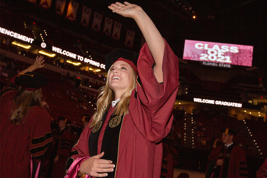 A graduating student waves during the ceremony. (FSU Photography Services)